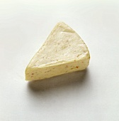 Triangle of a spreading processed cheese