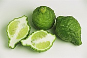 Kafir limes, two whole and one halved