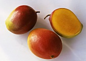 Two whole mangoes and half a mango