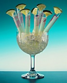 Kamikaze - alcoholic drink in small tubes in glass of ice