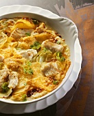 Fish and potato bake with kohlrabi in baking dish
