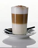 Original milky coffee in a glass (latte macchiato)