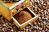 Ground coffee in the drawer of an old coffee mill