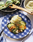 Courgette & carrot roll with mashed potato on plate