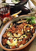 Aubergine & pepper casserole with sheep's cheese & tomato puree