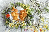 Baked Easter bunny & Easter eggs in spring flower wreath