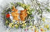 Baked Easter bunny & Easter eggs in spring flower wreath