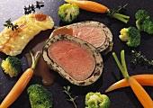 Two slices of veal fillet in morel casing and vegetables