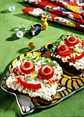 Cream cheese sandwich with vegetable face