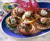 Small cakes with chocolate icing for children's party