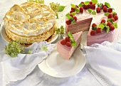 Almond cream meringue gateau & raspberry nut gateau, piece cut