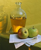 Carafe of cider vinegar, decoration: two fresh apples