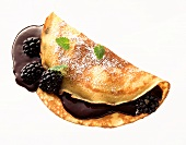 Crepe with blackberries and blackberry sauce
