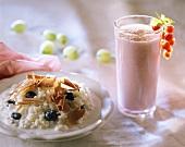 Rice pudding, blueberries & chocolate curls; berry milkshake