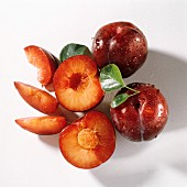 Two Whole Plums; A Halved Plum; Plum Slices