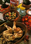 Mexican chicken on vegetables and bean and sweetcorn salad
