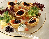 Pancake rolls with salmon & caviare, fish mousse dumplings