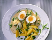 Boiled eggs with mustard & pepper sauce, peas & potatoes