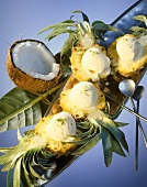 Coconut ice cream in baby pineapple halves