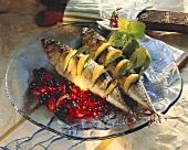 Smoked mackerel larded with lemon on berry sauce