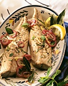 Marinated mackerel fillets with pepper and red onions