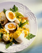 Cauliflower and mangetouts with turmeric sauce and eggs