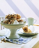Chocolate chip muffins in bowl and on plate on table