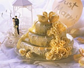 Three-tiered wedding cake with marzipan roses and swans