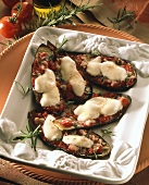 Stuffed aubergines with tomatoes and cheese au gratin