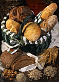 Basket of fresh bread & baguettes, décor: grain, nuts