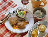 Vegetable and mince frikadellas with baked potatoes