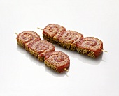 Two kebabs with raw meat and mince rolls