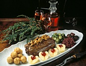 Venison with mushrooms, almond croquettes, pears &vegetables