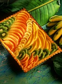 Tray-baked cake with exotic fruits