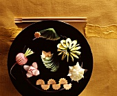 Asian vegetable carvings on plate