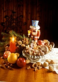 Mixed Christmas biscuits in bowl; fruit, nut cracker
