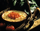 Linguine with Tomato Sauce in a Serving Bowl; Permesan