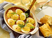 Gratin of gorgonzola & eggs on tomato sauce in gratin dish