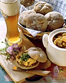 Roll with obatzta (cheese spread), Weissbier, bread basket