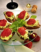 Snacks with avocado puree & strawberries on glass plate