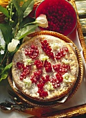 Redcurrant pie, decoration: redcurrants, flowers