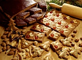 Various gingerbreads on wooden table, décor: rolling pin