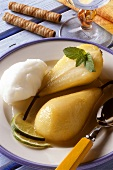 Stewed pears with lemon sorbet on plate