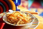 Pasta (fusilli) with oranges in deep plate