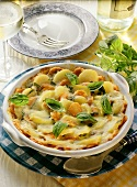 Carrot and potato gratin, garnished with basil leaves