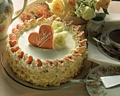 "Cream gateau with marzipan heart (and the word ""Valentine)"