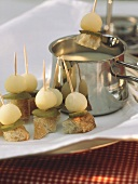 Bread kebabs with mixed pickles by & above cheese fondue pot