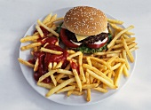 Cheeseburger with French Fries and Ketchup on Plate