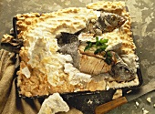 Bream with rice stuffing in egg & salt crust on baking tray