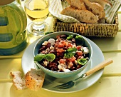 Red bean salad with tomatoes & sheep's cheese in bowl